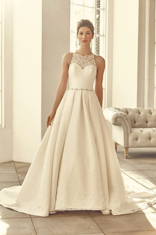 A stunning ball-gown dress with lace over satin and a key hole back.     <strong>Size: </strong>8 – 30 <strong>Colour: </strong>Ivory / Buttercup <strong>Fabric:</strong>  Lace over Satin <strong>Style:</strong> Ball Gown <strong>Neckline:</strong> High Neck <strong>Laced or Zipped: </strong>Zipped