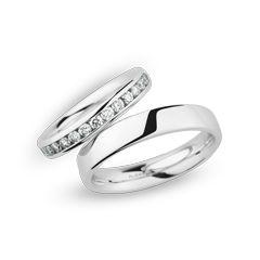 Trauringe Herrenring: Weißgold, Breite 4,5 mm Trauringe Damenring: Weißgold, Breite 3,0 mm, 15 Brillanten 0,50 ct. www.marrying.at