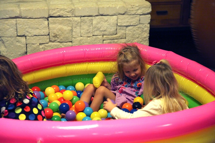 Inflatable pool ball pit. Great idea for a birthday party.