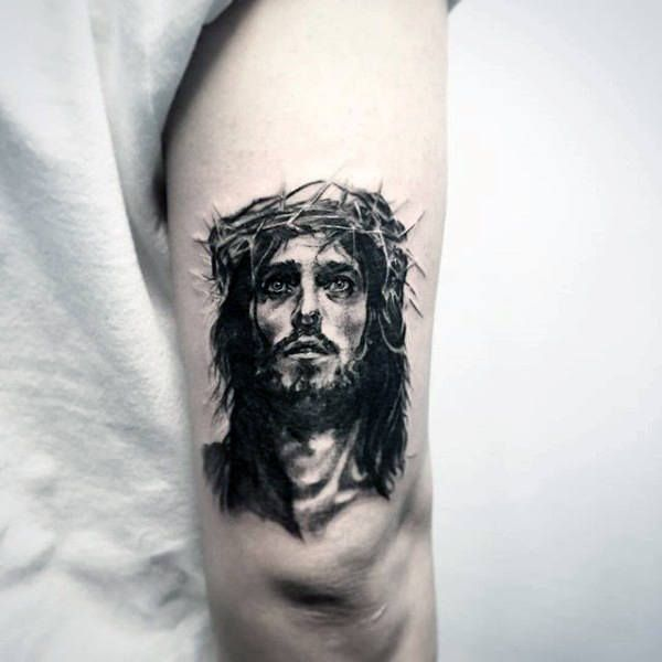 Guys Small Jesus Portrait Tattoo On Back Of Upper Arm