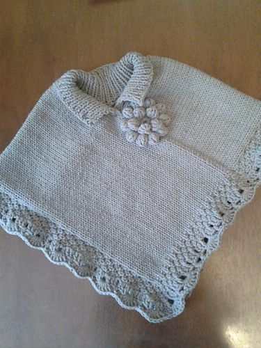Girl poncho with double seed stitch border. It fits age 3-4 yrs old. It also has…