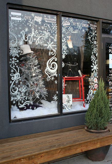 KARA PASLAY DESIGNS | Beautiful hand-painted snowflakes & swirls have a playful festive feel. #windowdisplay #visualmerchandising