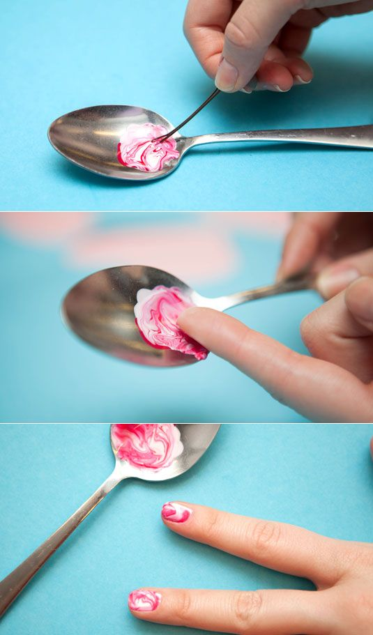 Give your nails a marble effect by swirling two polishes together and rolling your nail over the edge of the spoon. I'm trying this!