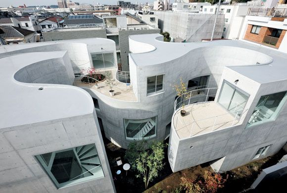 Kazuyo Sejima designed this nine-unit apartment in Yokohama with an undulating inner court. Each unit has access to either its own garden or roof terrace. The glimpses into this maze-like open space adds a unique character to the surrounding neighborhood.