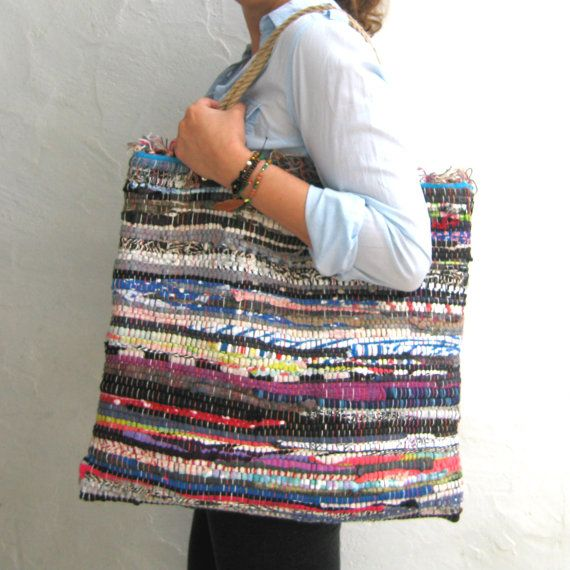 """If you are looking for a large tote bag that is unique, eye catching and super practical look no further!  This boho chic bag is made of a 'kourelou' which is a small rag made of various fabric scraps originally used for t-shirts.  This means that no two bags are identical. A totally eco-friendly bag that will fit all your shopping or beach gear and is soft enough to double as a pillow while traveling or sun bathing!    Size: approximately 17""""X18"""" (43X46 cm)  Handle length: 20""""(50 cm)  Jute…"""