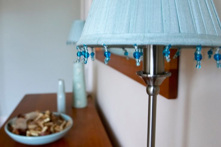 Elegant Edwardian bedroom, pale blue interior, blue lampshade