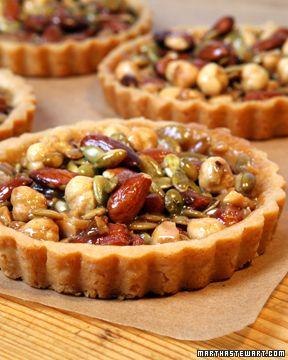 Nut picnic tarts; hazelnuts, almonds, macadamia and other nuts baked into savoury tartlets... via Martha Stewart.