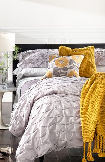 Gorgeous bedding. Love this yellow and gray palette. And all of this pretty texture.