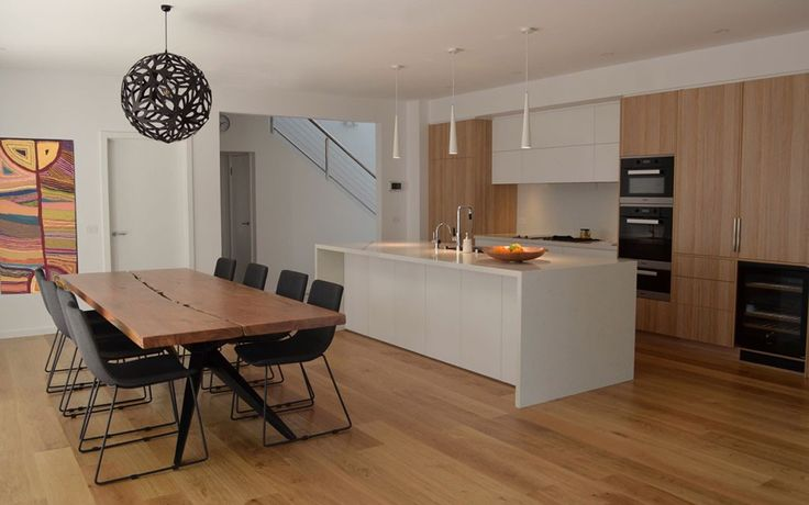 The renovation of a dated kitchen, living area and bathrooms. Done on a limited budget using high quality laminates to achieve the look of real timber