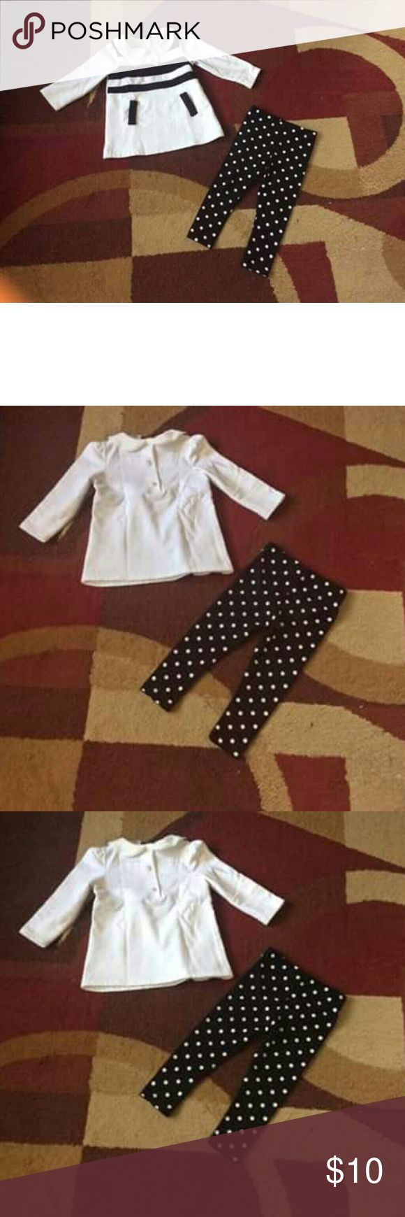 Baby girl legging outfit 18m Excellent shape Savannah white polka dots pants outfit18m color black & white.Top is stripes black & white & 3 buttons on back. Used couple of times from new. 95% cotton & 5% spandex made in China. From smoke & pet free home. No holes & no stain. Bundle for less & save shipping. Have a great day! Savannah Bottoms Leggings
