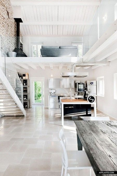 neutral white colors, stone floors, rustic table