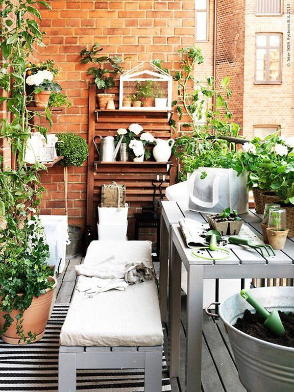 This is a rather busy looking but cozy balcony set up. Fill your balcony with wooden shelves and tables to serve as places where you can place your potted plants. It's easier for you to reach and water your plants and they look like good decorations as well.