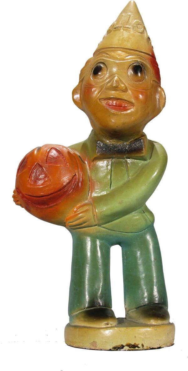 Great vintage chalk ware Halloween Man Holding Pumpkin.