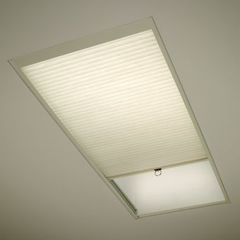 Don't let all your heat escape through your skylights. Cover it with an insulated Duette shade from Hunter Douglas.
