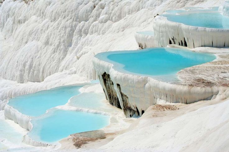 """Slide 4 of 26: Calcite-laden waters have created a surreal landscape with sparkling white travertine terraces and warm, mineral-rich pools in southwestern Turkey, fittingly called <a href=""""http://www.fodors.com/world/europe/turkey/the-central-and-southern-aegean-coast/places/pamukkale-hierapolis"""">Pamukkale</a> (Cotton Castle). At the end of the 2nd century B.C., the ancient spa city of <a…"""