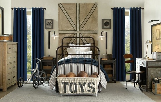 Navy and cream color scheme with industrial accents is a look that could last from a young boy's room through pre-teen and beyond.