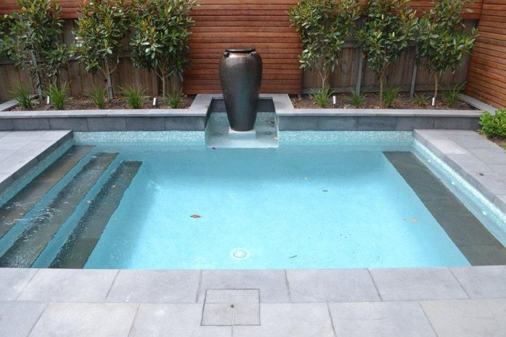 This #landscaping design focuses on strong geometric lines. #Bluestone #pavers are the perfect choice as a paver due to its consistency and blue grey colour.