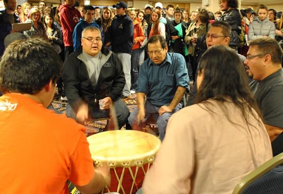 Students listen to Mik'maq drummers. Photo: Marites N. Sison