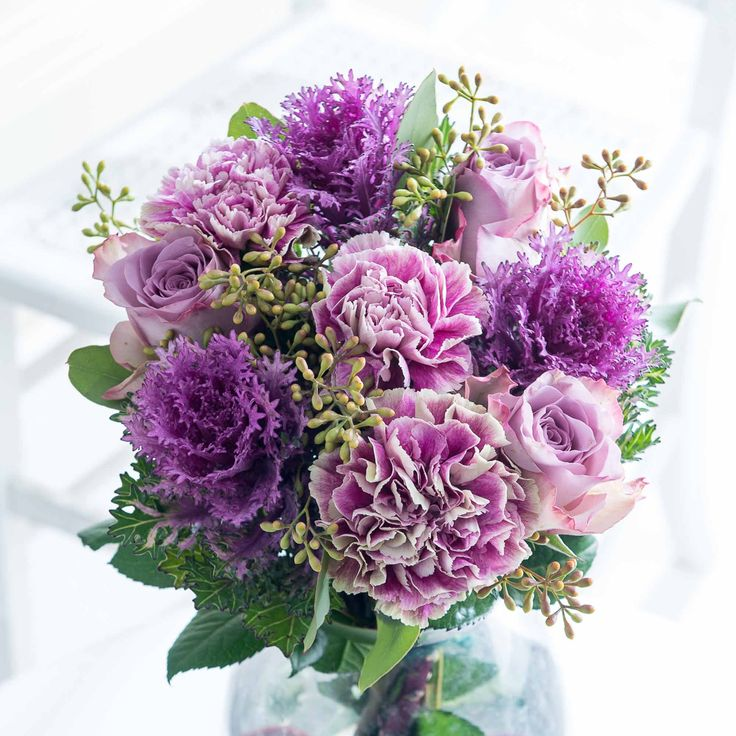 Delicate Blush: This delicately textured bouquet makes a perfect gift for any occasion. British frilly brassica are arranged beautifully with elegant lilac roses and carnations - stunning!