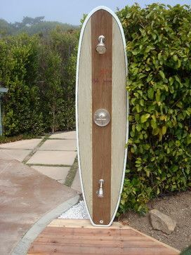 Surf board beach themed open air outdoor shower.