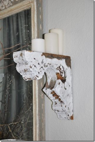 Add a vintage paint job to a corbel and use it as a candle shelf in entryway--good idea for reuse of my old corbel in the living room to add some color to the tone on tone, maybe chartreuse candles?