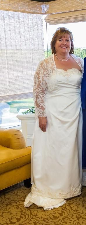 This plus size wedding dress has a long sleeve shrug jacket made of sheer beaded lace. The main dress is a sweetheart cut design with a satin skirt. Get pricing on custom plus size #weddingdresses like this (as well as replicas of couture gowns for less) at www.dariuscordell.com