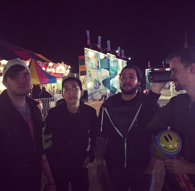 Dex, Aron, James, and Spencer at a carnival during their 'Road to E3' 2015 trip.