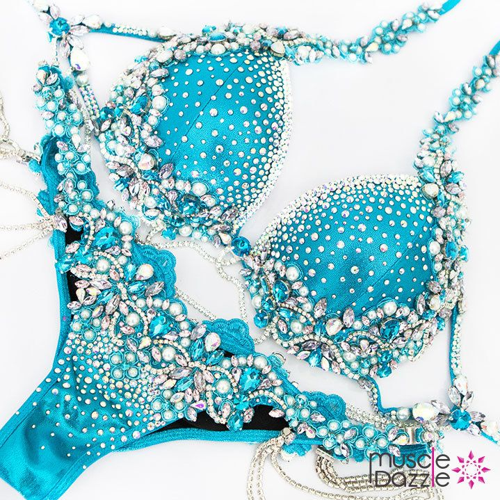 Heads will turn... jaws will drop!  This blue bikini competition suit is a beautifully styled design of clear and blue rhinestones, larger crystals, pearls, chain and lace. Blue WBFF Bikini Competition Suit DV025. #muscledazzle #competitionbikini #crystalbikini #bikinicompetition #wbff #wbffbikini #wbffbikinidiva #wbffdiva #wbffbikinipro #wbffpro #bikinidiva #divabikini #fitnessdiva #couturebikini #wbffbikinis #couturebikinis #competitionprep #wbffasia #contestprep