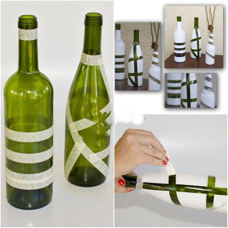 Jarrón blanco con bandas de vidrio verde gracias a una aplicación de pintura.