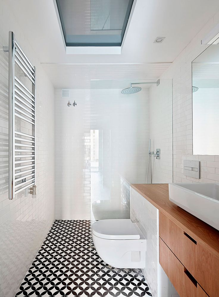 family bathroom | wall mounted toilet | patterned floor | integrated countertop with vanity | vessel sink | curbless shower