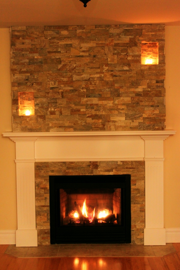 Our faux chimney By Stepping Stone and Tile #SST added to this propane fireplace.  Follow Us on Facebook for more ideas and examples!
