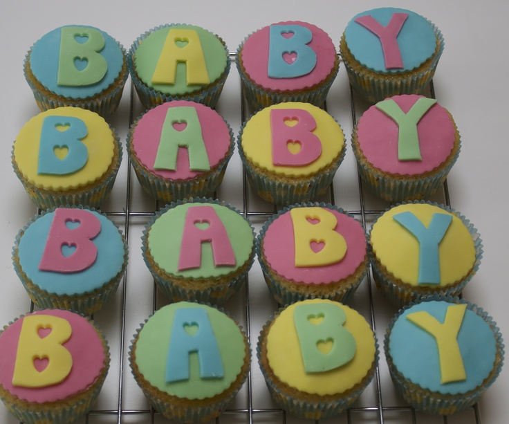 Baby shower cakes - Vanilla cupcakes with fondant icing and a secret vanilla and raspberry jam centre