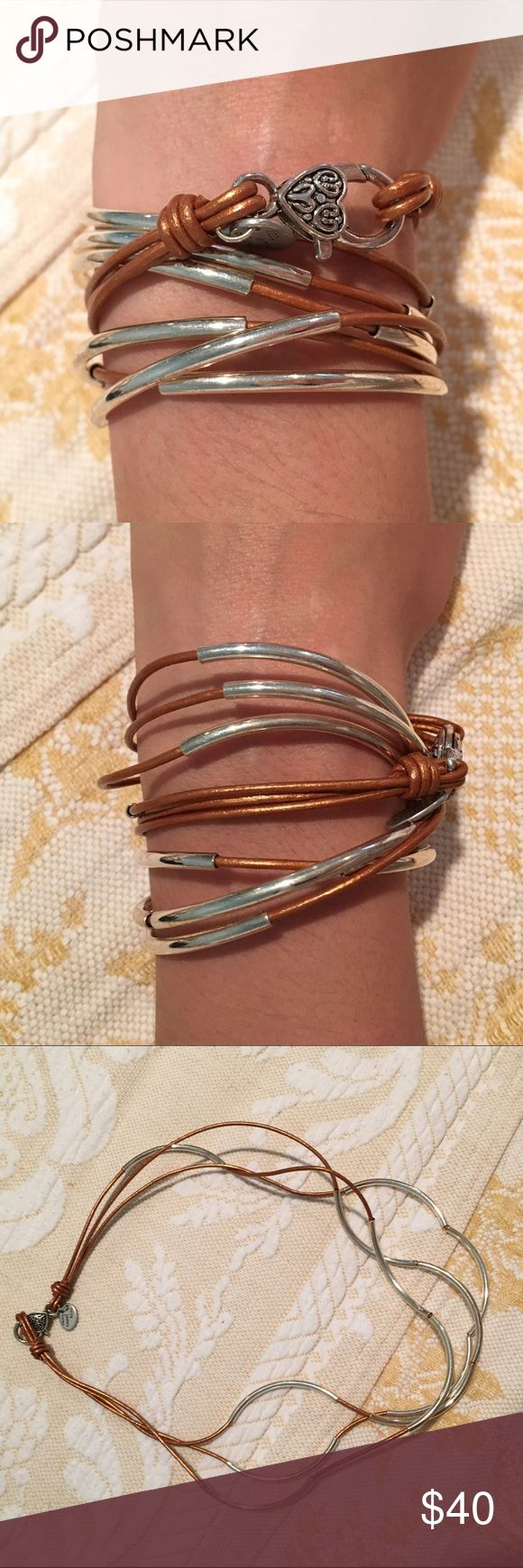 """Lizzy James Design - 3 strand wrap bracelet Made of metallic gold leather and silver plated metal. Can be worn as a necklace or bracelet. About 20"""" long Lizzy James Jewelry Bracelets"""