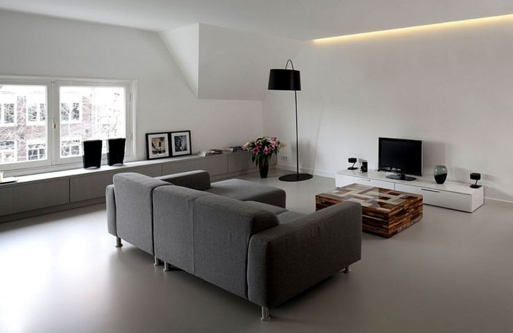 Interior, Fabulous Modern Living Room With White Wall Including Transparent Glass Windows And Grey Puffy Sofa With Wooden Table Featuring White Wooden Cabinet Beside Standing Lamp Above Grey Slate Floor ~ Interior Design Ideas with Beautiful White Minimalist Decoration