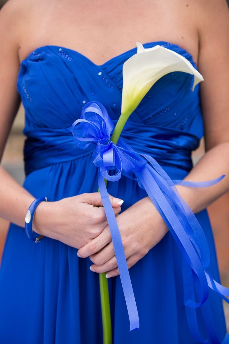 A single calla lily for the bridesmaid is a classy and understated statement and beautifully compliments the bride's bouquet. Tie with matching ribbon to complete the look. ~ Photo:  Baudoux Photography