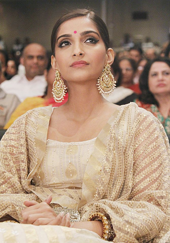 Sonam Kapoor wears a golden anarkali and statement earrings. Love her makeup and hairstyle.