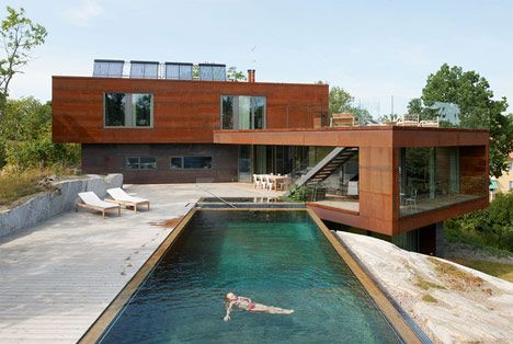 ...---=== Designed by Swedish architects DAPstockholm, the three-storey Villa Midgård and its swimming pool are set into the inclining landscape.