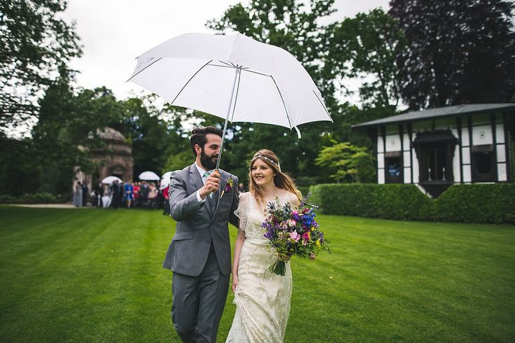 Bride and groom from an outdoor rainy day Midsummer Night's Dream Inspired Garden Wedding. Photography by Mylo Photography
