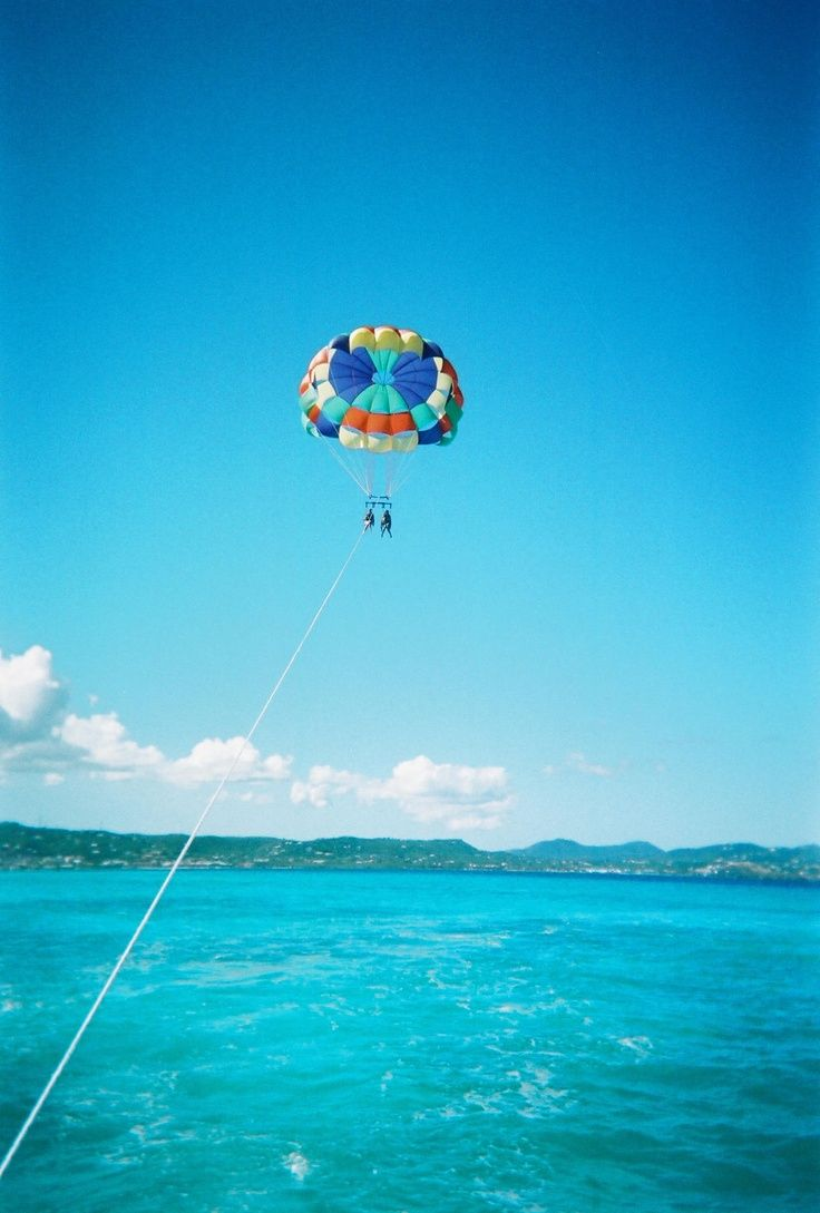 Parasailing over the Caribbean sea, off the coast of ...