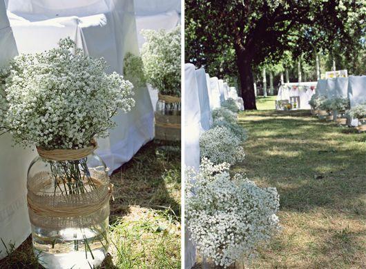 Decoración de bodas con tarros de cristal y paniculata (Foto, ©Bodas de Cuento, The Wedding Designers)