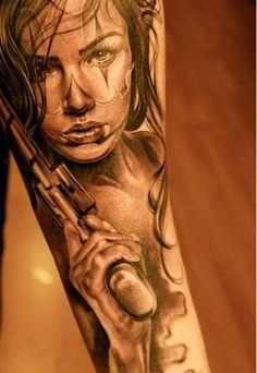 She's a pistol! - arm tattoo
