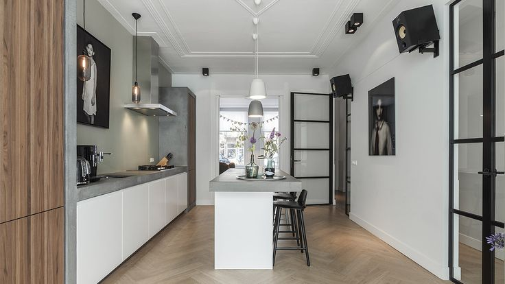 Industrial kitchen with concrete counter top, design by BNLA architecten.