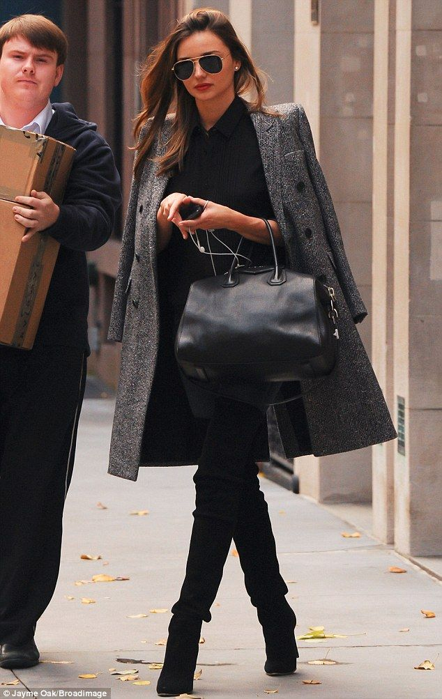 Sexy soles: Miranda Kerr wore some thigh-high boots to do some shopping in New York on Saturday