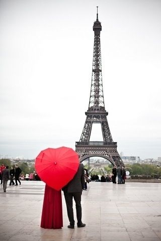 Couple standing in front of Eiffel Tower. Beautiful