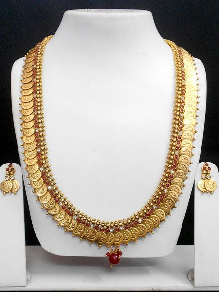 Exclusive set of high quality copper based coin polki jewellery, This polki jewellery set avaialable with matching pair of earrings.The Necklace set and the earrings both are designed beautifully with