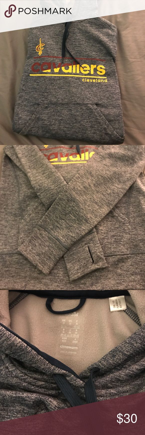 Adidas Cavs sweatshirt Perfect condition! Heathered navy and grey with silver adidas logo, and the maroon and gold cavs logo. Super warm hoodie ( climawarm collection) sleeves even have thumb holes! adidas Tops Sweatshirts & Hoodies