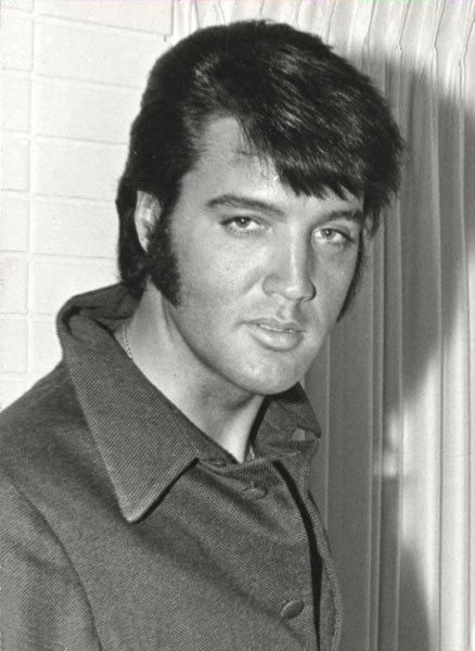 Good gosh a'mighty.  He kind of has a Dean Martin look about him in this pic