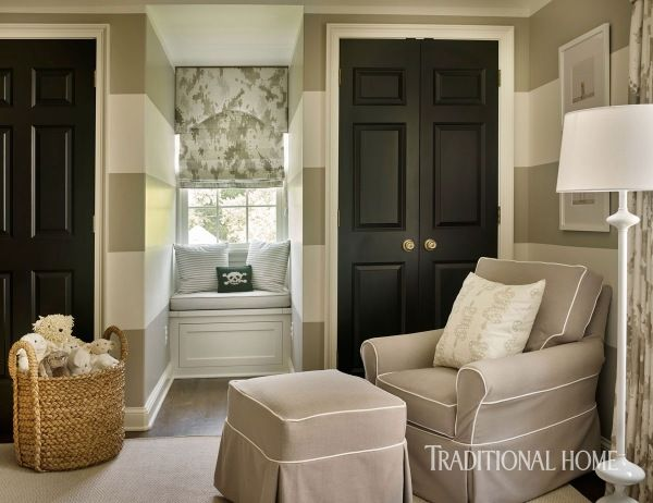 A sweet reading area in the neutral nursery also showcases the home's signature pop of black on the closets doors. - Photo: Emily Jenkins Followill / Design: Courtney Giles