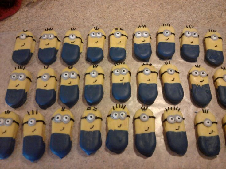 Minion cookies: Dip Vienna Finger cookies half in yellow, half in blue candy melts. Wilton eyes, gray icing for goggles, black icing for other features.