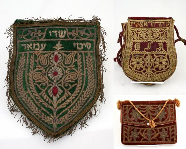 """A SEPHARDIC AMULET, A TEFILLIN BAG AND A TALIS BAG. Morocco, 19th century. The first, a cartouche shaped tefillin bag. With gold thread embroidered Hebrew name, 9"""" long. The second, an embroidered amulet, 10"""" tall. The third a large tallis bag embroidered with a Jewish star. 10"""" wide."""